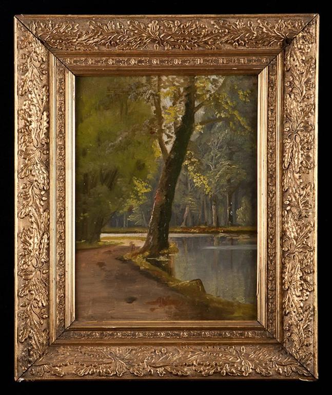 A lovely oil painting on panel of a riverscape scene with sunlight filtering down through the deciduous canopy, with original gilded frame. Written in two hands along rear of painting on the border, is the name of the family who owned the painting