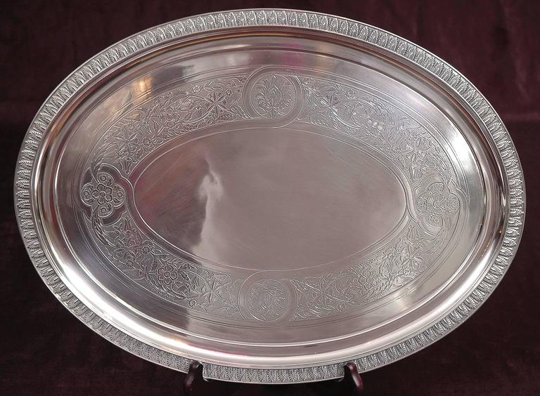 """This lovely sliver plate Tiffany tray was fabricated for commercial use in 1957. Palmette design decorates border, with floral design in banding along center.  Measures: 18"""" long x 13 3/8"""" wide x 1"""" high."""