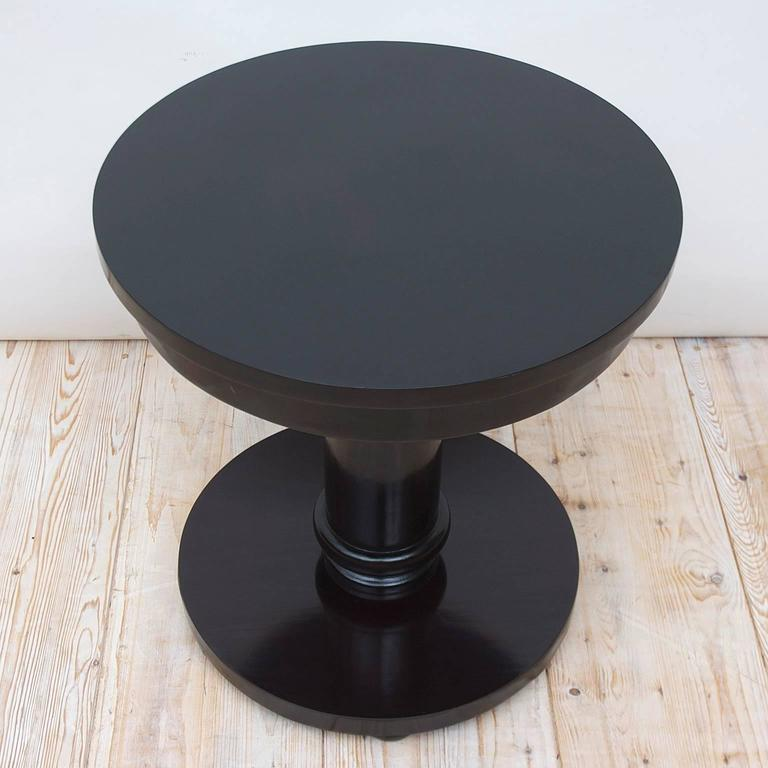 A beautifully crafted custom table in our workshop in the Scandinavian Art Deco Style with round top on cylinder column resting on round base. Constructed from poplar, table has an nitrocellulose lacquer painted finish compounded and the over