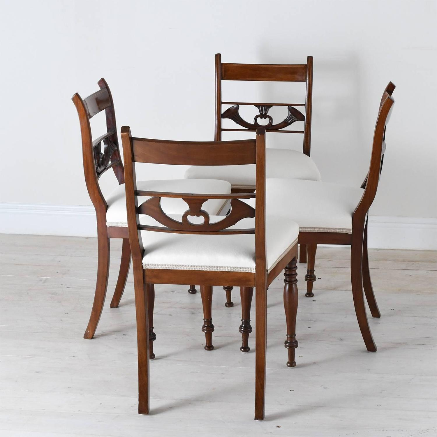 Set of four english regency dining chairs in mahogany with for Upholstered dining chairs for sale