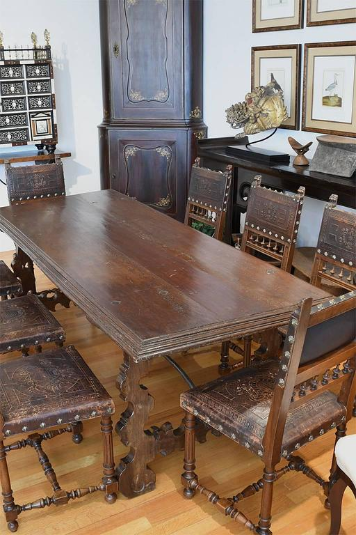 A Beautiful And Rustic 18th Century Spanish Dining Table In Walnut With Plank Top