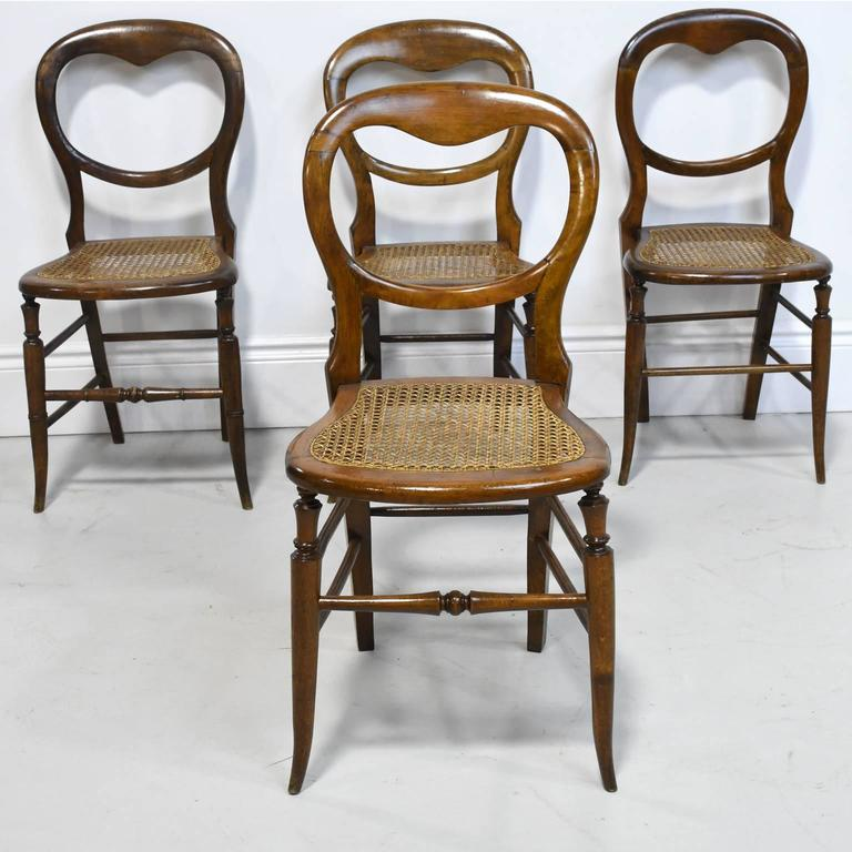 A Charming Set Of Four Louis Philippe Dining Chairs With Balloon Backs,  Splayed Legs And