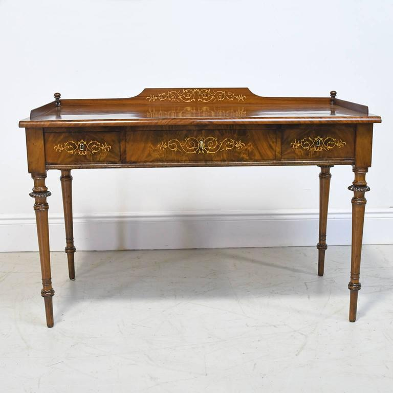 This exceptional writing table with three drawers is from the reign of Christian VIII of Denmark. The Cuban mahogany employed is of an extraordinary grade and the oxidation that has naturally occurred from exposure to light has left it with a