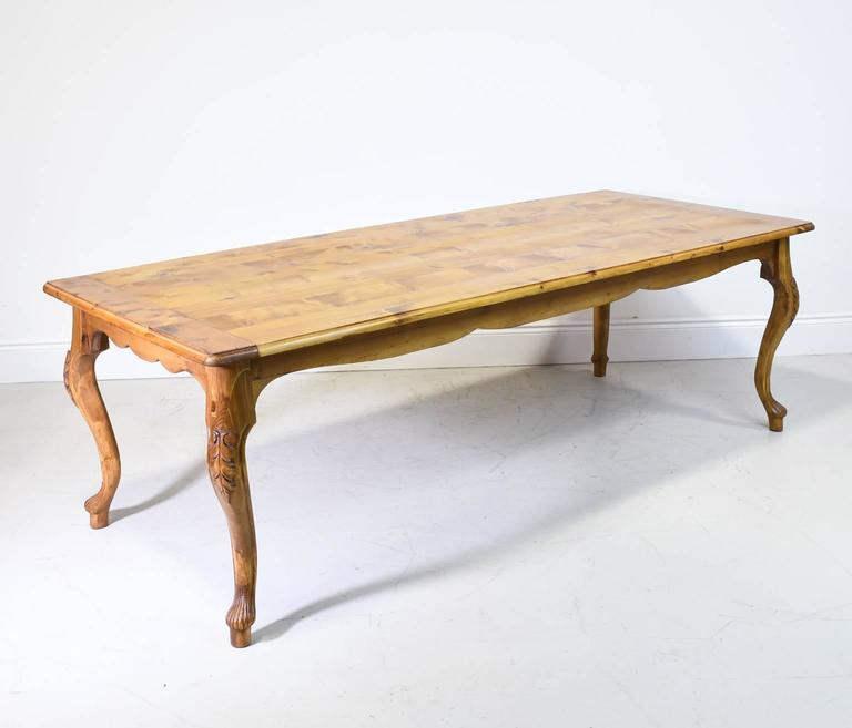 A Pine Farmhouse Dining Table In The French Provincial Style With Cabriole Legs Carved Acanthus