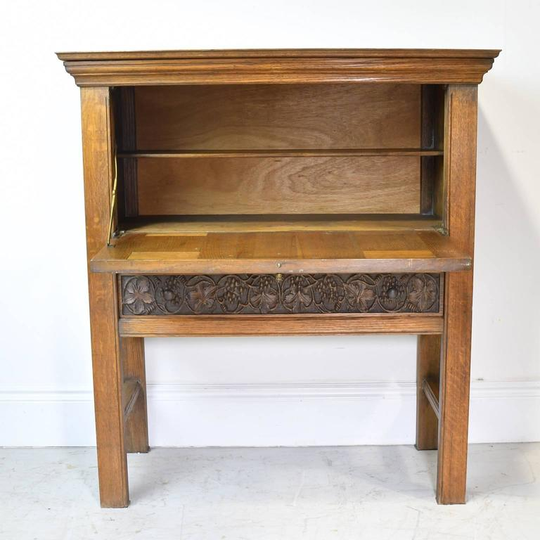 Early 20th Century Arts & Crafts Bar Cabinet in Oak with Carved Panels 2