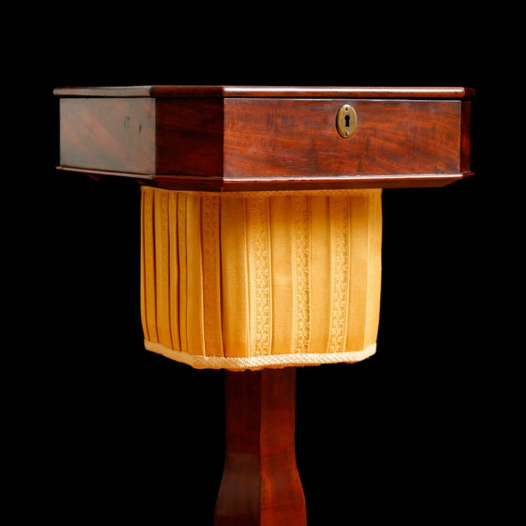 Perfect side table or wine table next to a chair of sofa. A very beautifully-proportioned and handsome Empire/Biedermeier sewing table that would have been used for needlework in an elegant salon. Square lift-top is hinged, opening to a series of