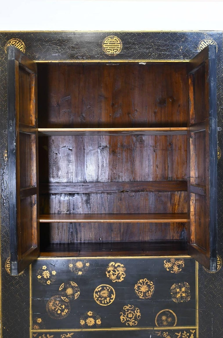 Chinese Qing Cabinet With Black Lacquer And Gold Painted