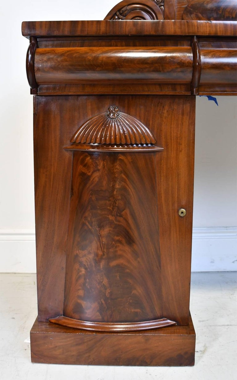 Hand-Carved English Regency Pedestal Sideboard in Mahogany with Carved Backboard, circa 1830 For Sale