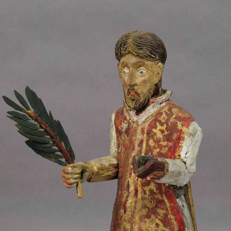 A beautifully hand-carved and hand-painted sculpture of a saint with palm-branch. Most probably Armenian or Georgian, circa 1850.