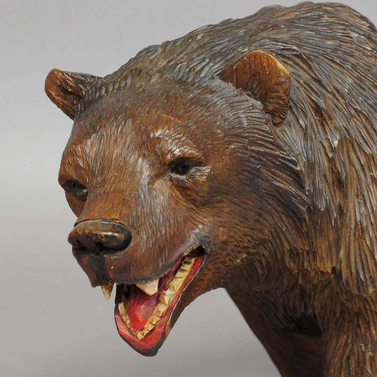 Large wooden strolling bear carved in brienz at stdibs