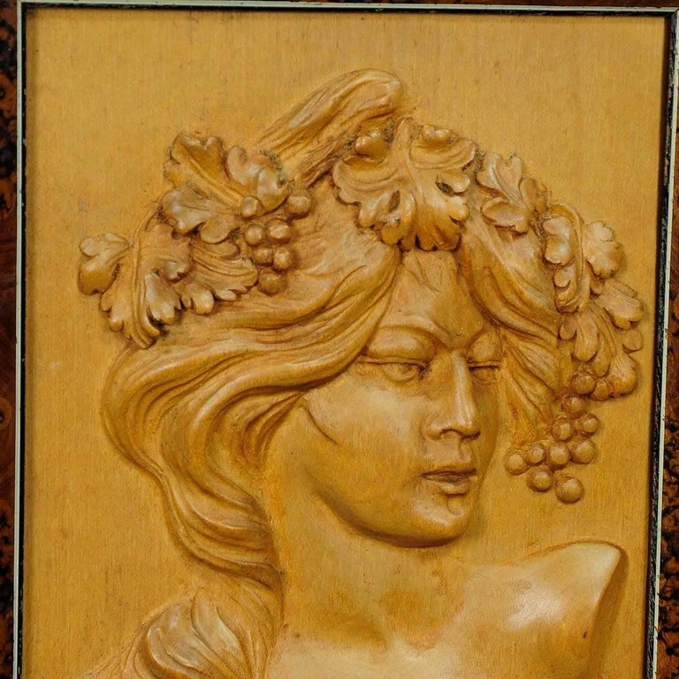 A lovely wooden wall application depicting a Victorian lady with grapes and wine leaves in her hair. Hand-carved, circa 1920 in Germany.  Measure: width 5.71