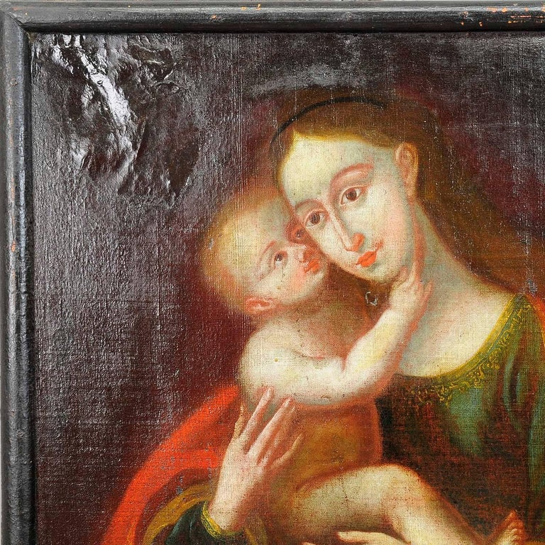 An antique oil painting depicting the holy mother with child named the Miraculous Image of Innsbruck. Oil on canvas with pastel colors. Painted after a painting of Lucas Cranach which is part of the altar in the cathedral of Innsbruck. Framed with