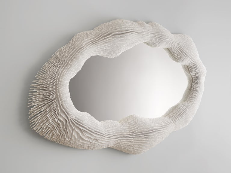 From simple beech rods patiently cut, sanded, arranged and lacquered, Pia Maria Raeder creates refined functional sculptures that evoke biomorphic forms. Each work in the collection 'Sea Anemones' is handmade. More than 210 hours of work and 16,000