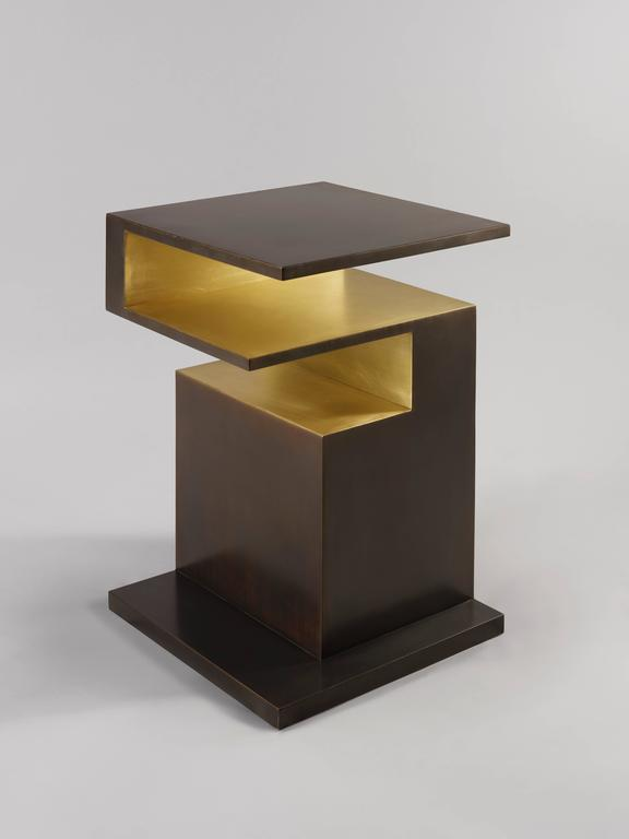 'XiangSheng II Side Table' is a collectible design work that combines champagne colored brushed bronze surface and oxidized bronze with an intense brown patina. This elegant table is part of the 'XiangSheng' furniture collection by much acclaimed