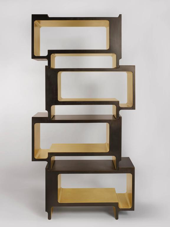 'XiangSheng II Shelving Unit' is an elegant collectible design work that combines champagne colored brushed bronze surfaces, and oxidized bronze with an intense brown patina. This limited edition bookcase includes four individual units. Units can be