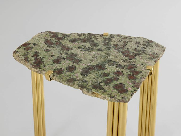 Taher Chemirik's 'Pathway' is a signed, unique set of five tables that each combines varnished brass tubular legs and top, and an eclogite natural rare hard stone top. Each of the five tables is handmade and different, and a spectacular evocation of