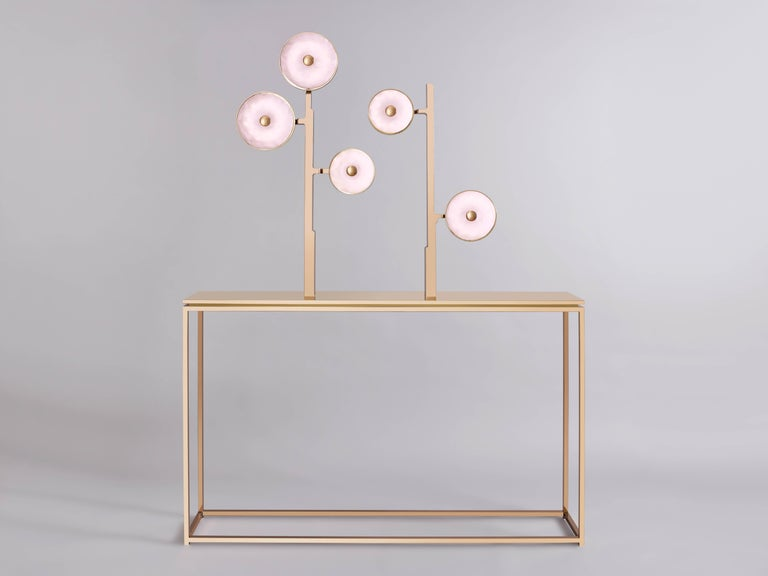 This 'JinShi Pink Jade' glamorous luminous console by acclaimed design duo Studio MVW is a true jewel for the home. It encompasses five retro-lit heads in natural pink jade, an exceptional gemstone with a sumptuous powder transparency, and a