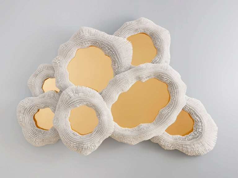 From simple beech rods patiently cut, sanded, arranged and lacquered, Pia Maria Raeder creates refined functional sculptures that evoke biomorphic forms. Each work in the collection 'Sea Anemones' is handmade. More than 350 hours of work and 27,000