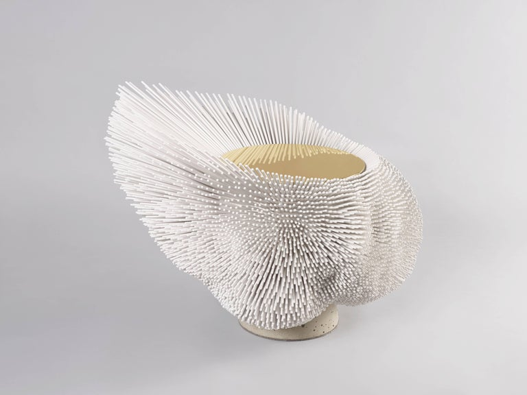 A poetic piece of collectible design, this 'Sea Anemone' table was handcrafted by Pia Maria Raeder from 8,000 beech rods that were patiently cut, sanded and arranged one by one by the artist herself. This piece includes a brushed brass top and a