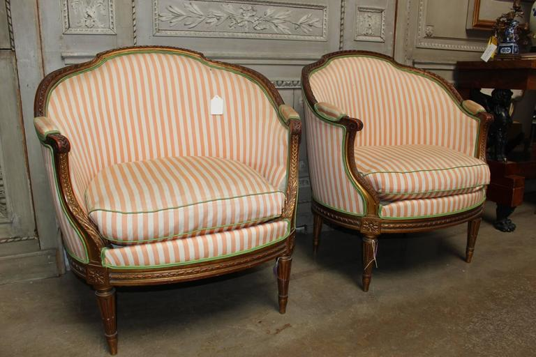 A pair of French Louis XVI style gilt wood marquises