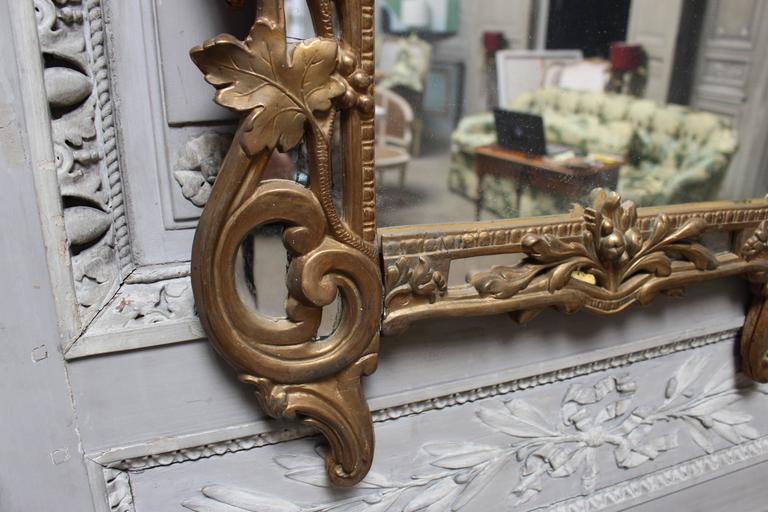 A French Regence Style Small Scaled Gilt Wood Mirror In Fair Condition For Sale In Dallas, TX