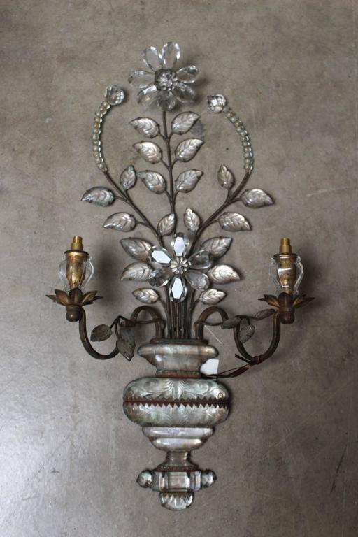 A pair of early Maison Baguès two-light crystal and metal sconces.