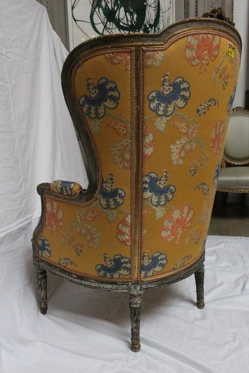A beautifully carved and large Louis XVI style bergère with painted finish.