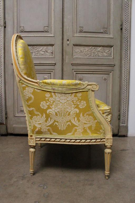 A very large pair of French Louis XVI style begeres with a painted finish.