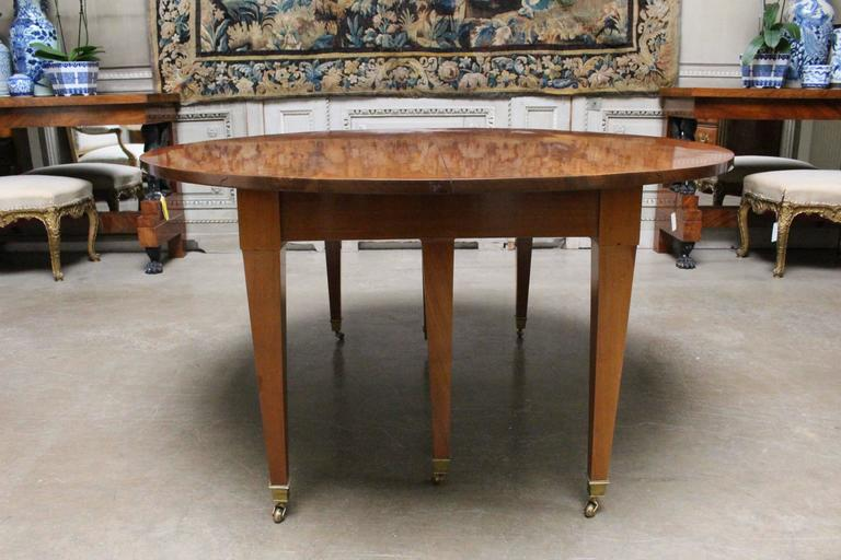 A French XVI mahogany extension dining table with three mahogany veneered leaves from a later date.