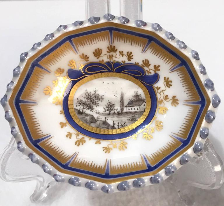 This pair of Master Salt Cellars has the blue under glaze mark of Nymphenburg.