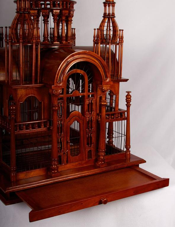 Cleaned and fully restored architectural birdcage of rather large-scale. Beautiful turned and shaped columns, rounded turrets and a large center dome which is removable, complete this fabulous and very useable bird cage. Within the base you will