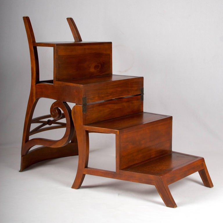This is a classical mahogany library chair that transforms into a very sturdy ladder for those taller shelves. The chair is very well made and has only some minor scratches underneath the steps. A very useful piece of furniture if one needs a