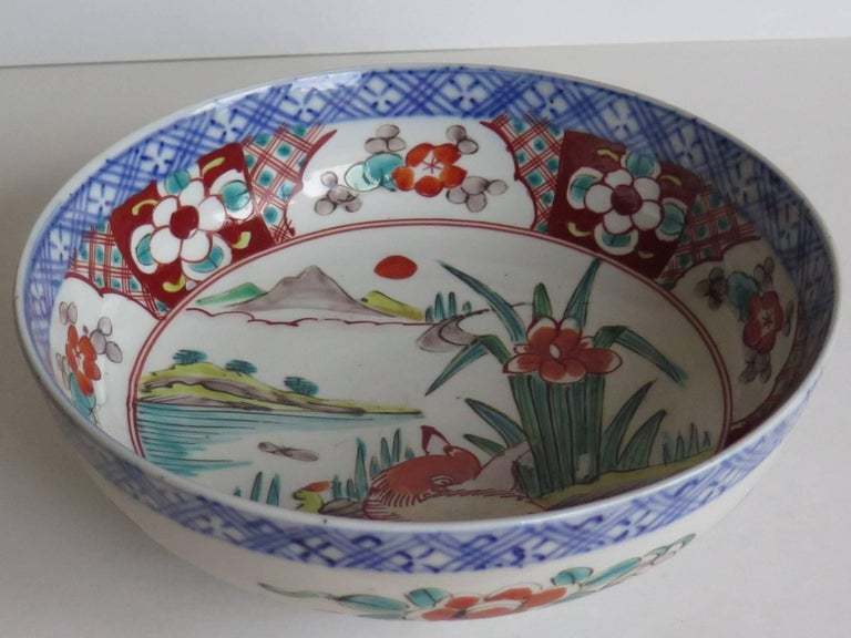 This is a good and very decorative porcelain footed bowl, hand-painted in polychrome enamels and dating to the later part of the 19th century, circa 1870, Meiji period.  The bowl is circular and well hand potted on a fairly deep foot.  This bowl