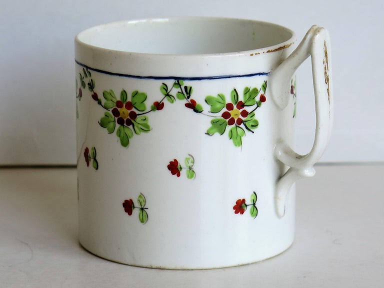 This is a very collectable, hand-painted porcelain coffee can (cup) , made by Derby Porcelain Co., England in the George III period, circa 1800.  The coffee can is straight sided and nominally 2.5 inches square excluding the handle. The handle is