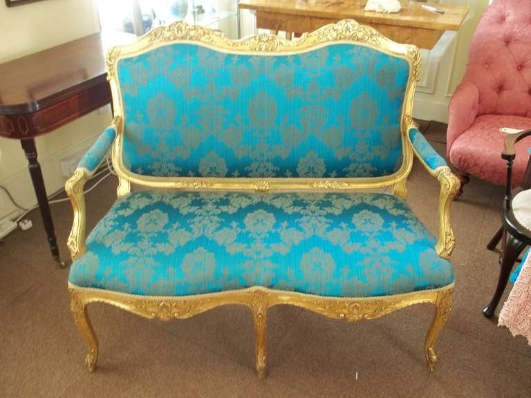 This is a high quality elegant, English settee or sofa in the French Hepplewhite revival or Louis XV style, made in the mid-19th century and reupholstered in a silk brocade damask fabric.