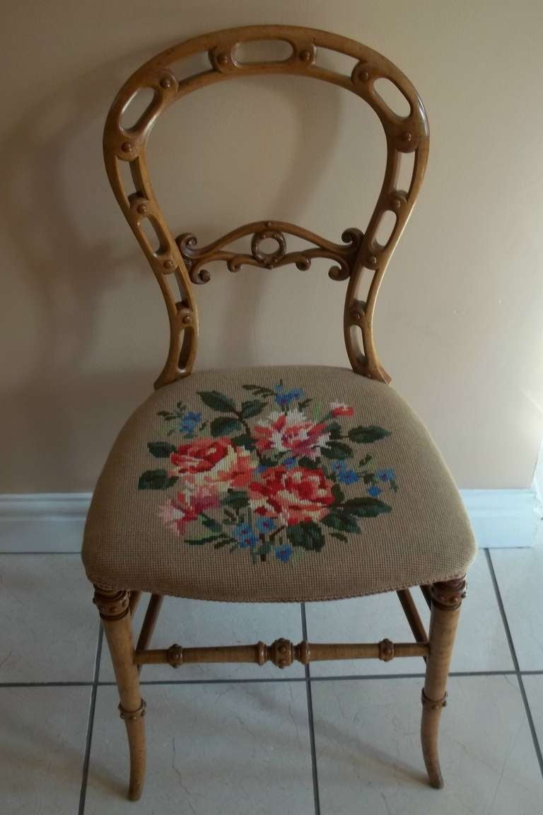 This is a very good quality example of an English occasional side chair in the Rococo style, from the mid Victorian period, circa 1850, made from Beech.  The back is a Classic balloon back shape, but with intricate cut-out and carved detail to the
