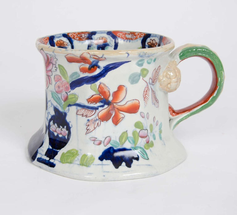 This is a large and impressive hand painted Cider Mug or Tankard made by Mason's Ironstone, England, with a very early date in the Georgian period, circa 1815.  These very early large cider mugs / tankards are quite rare.  The mug is octagonal in