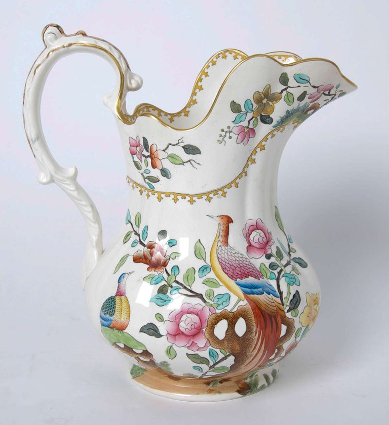 This is a very large and impressive jug or pitcher over 12 inches tall, made by the Copeland (Late Spode) factory in the late 19th century of Victorian England.  This piece is made of earthenware and is well decorated in the oriental pheasant