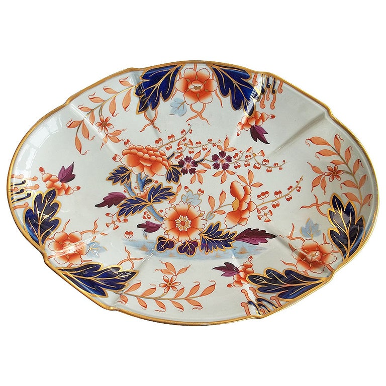 This is a beautifully hand decorated ironstone large dish, bowl or serving platter made by William Davenport and Co., Longport, Staffordshire Potteries, England, circa 1810.