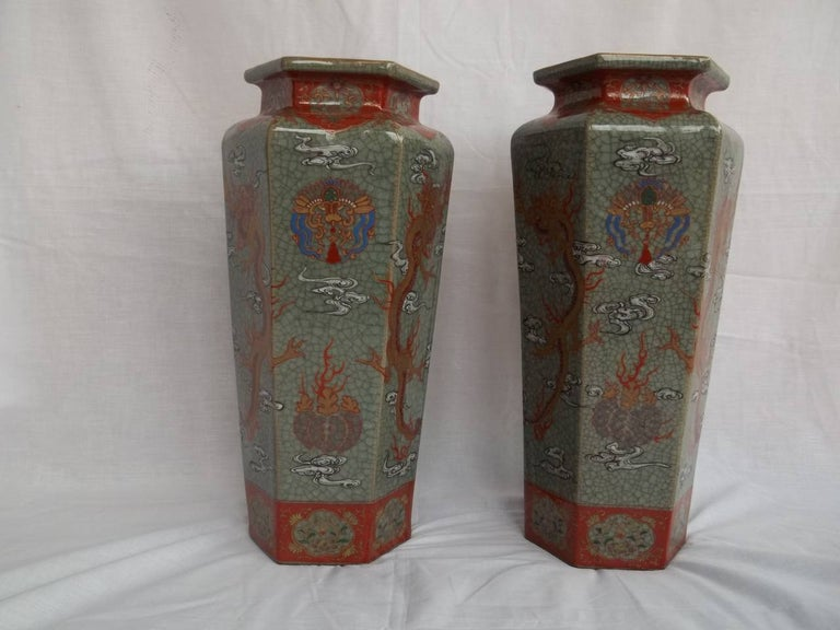These are a very beautiful, decorative and unusual pair of hand painted Chinese porcelain Vases, having a hexagonal form with a high shoulder and short lipped neck, that we date to the late Qing period, circa 1900.  They have a celadon, grey / green