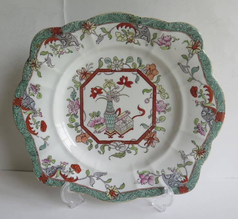 This is a sandwich dish or plate by Mason's Ironstone, England, dating to the first half of the 19th Century, Circa 1940.  These dishes are fairly rare, having a moulded and slightly fluted square shape.  This dish is decorated in the Vase and Box