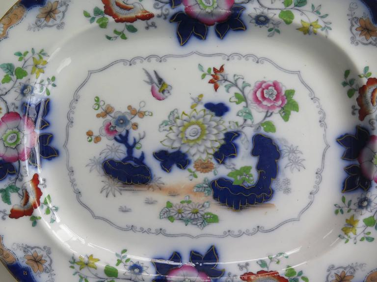 This is a good large English ironstone platter by F Morley (Mason's Ironstone) from the mid-19th century.  It was manufactured by Francis Morley & Co. of Shelton, Hanley, Staffordshire, England. Francis Morley bought the Mason's Ironstone designs,