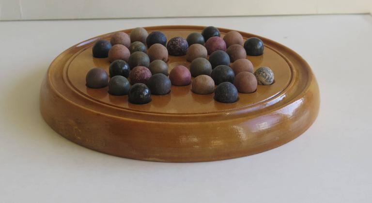 Stone 19th Century Marble Solitaire Board Game with 32 Handmade Marbles, Circa 1880 For Sale