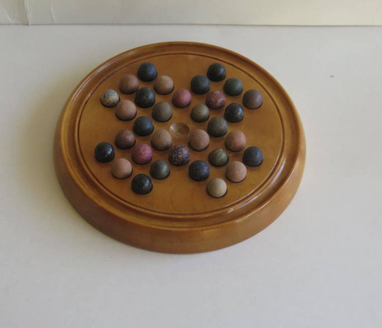 English 19th Century Marble Solitaire Board Game with 32 Handmade Marbles, Circa 1880 For Sale