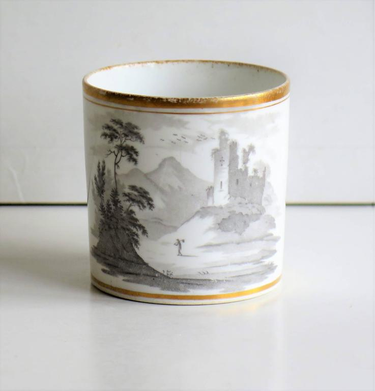 This is a good example of an English George III period, porcelain, coffee can, made by Spode, England in the early 19th century, circa 1810-1815.  The can is nominally straight sided and has the Spode loop handle with a pronounced kick or kink to
