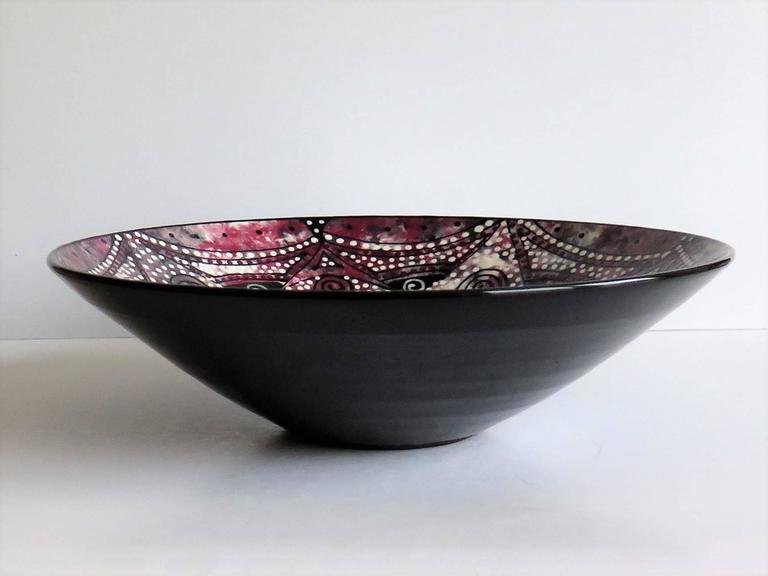 This is an unusual, beautiful and very decorative, Studio Pottery bowl.  The bowl is hand thrown and finely potted.  It is hand painted to the inside with a mottled dappled effect using colors which include white, grey, blue, red, pink, all in