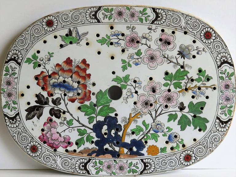 This is a good rounded oval ironstone (stone china) drainer plate, Circa 1830, which we attribute to the factory of Hicks, Meigh and Johnson of Shelton, Staffordshire Potteries, England, who made good quality earthenware and ironstone wares between