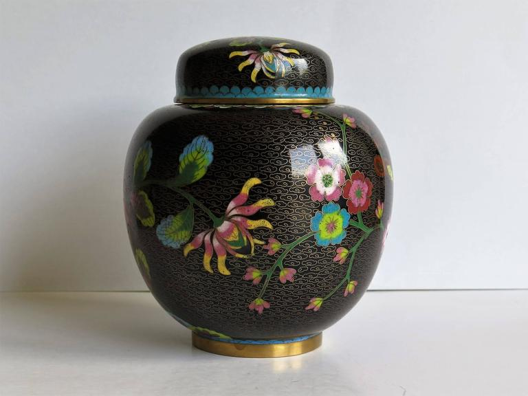 This is a very decorative cloisonné lidded jar or ginger jar, made in China in the late 19th century.