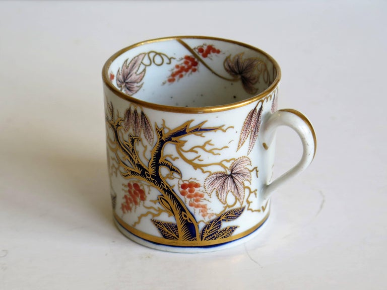 This is a beautifully hand-painted English coffee can, from the late George-III period, of the very early 19th century, circa 1805.