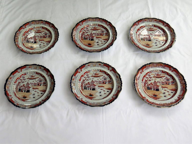 These are a beautiful set of six Mason's ironstone large dinner plates made during the mid-19th century, when Mason's was owned by Ashworth Brothers, circa 1865.  The plates have a detailed Chinoiserie pattern depicting a pagoda lakeside scene with